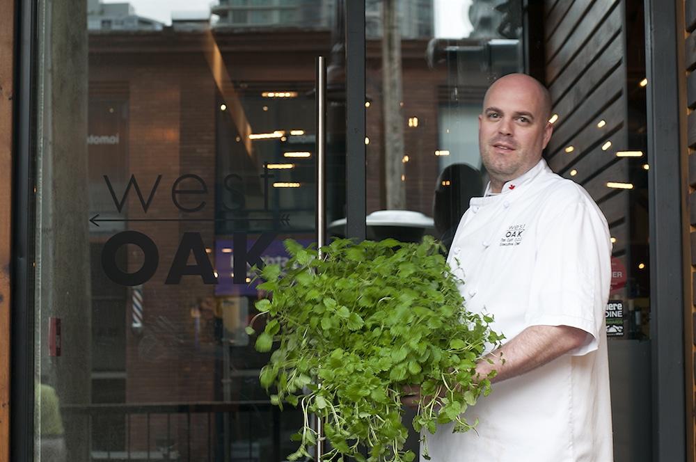 Chef Tim Cuff holding Urban Cultivator grown herbs